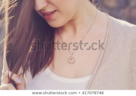 woman wearing shiny diamond necklace Stock photo © dolgachov