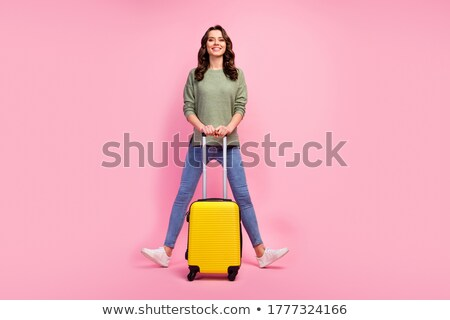 Beautiful girl with suitcase Stock photo © Aikon