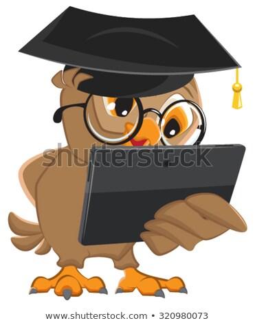 Owl teacher holds tablet computer stock photo © orensila