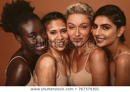 Stock photo: Faces of four multi-ethnic women