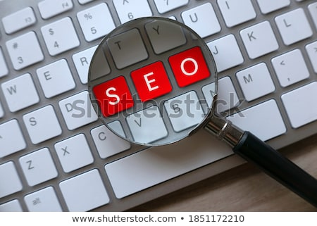 business optimization   written on red keyboard key stock photo © tashatuvango