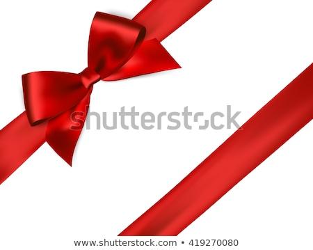 Czerwony satyna dar łuk wstążka odizolowany Zdjęcia stock © teerawit