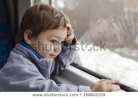 little boy looks in train`s window stock photo © Paha_L