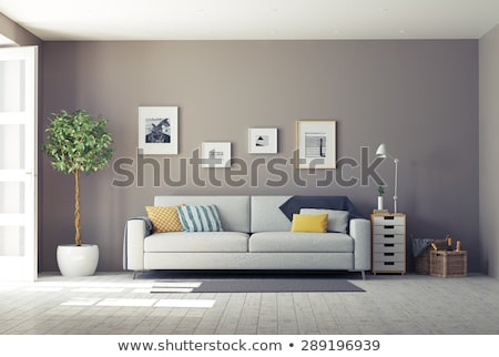Stock photo: Cozy living room with a wall of pictures