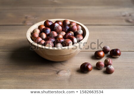 Plenty of ripe hazelnuts in bowl Stock photo © stevanovicigor