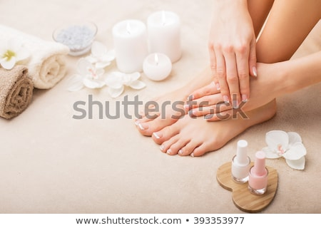 Woman feet with french pedicure Stock photo © svetography