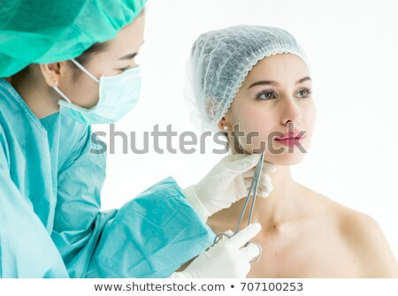 hands threading beautiful womans face stock photo © wavebreak_media