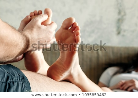 close up of a woman receiving foot massage stock photo © wavebreak_media