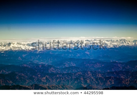 flying over the Himalaya in the morning with sunrise Stock photo © meinzahn