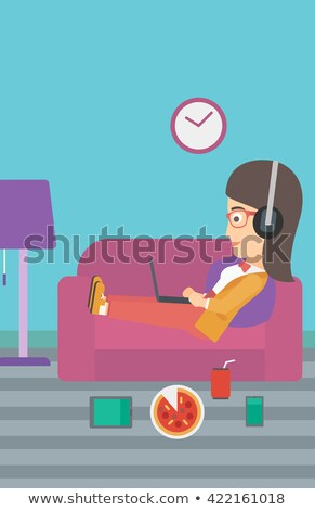 woman lying on sofa with many gadgets stock photo © rastudio