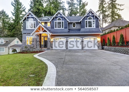 A big concrete house with an attached garage Stock photo © bluering