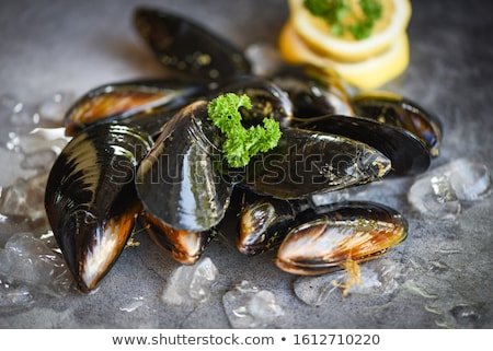 Fresh mussels for sale on a market  Stock photo © elxeneize