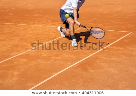 male tennis player in action on the clay court on a sunny day stock photo © smuki