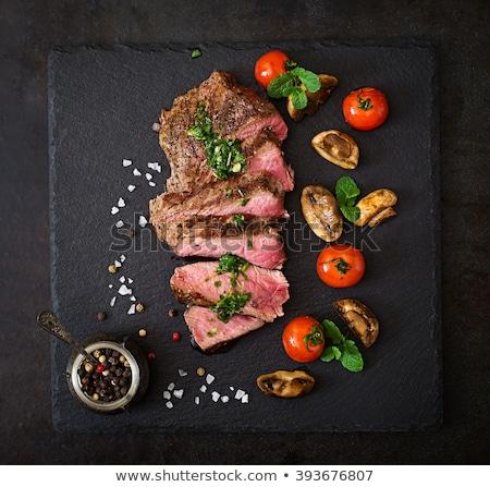 Sulu biftek nadir sığır eti baharatlar karanlık Stok fotoğraf © artjazz