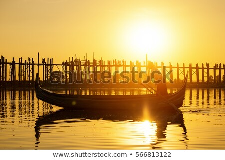 Stock photo: Fishman under U bein bridge at sunset
