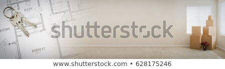 Gradated Banner with House Keys, Plans and Empty Room with Boxes Stock photo © feverpitch