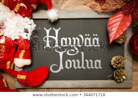 Hyvaa Joulua greeting card - Merry Christmas in Finnish Stock photo © RedKoala