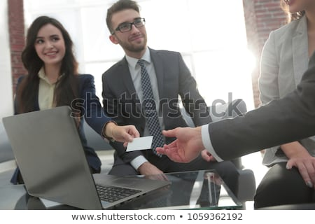 two businesspeople exchanging visiting card stock photo © andreypopov