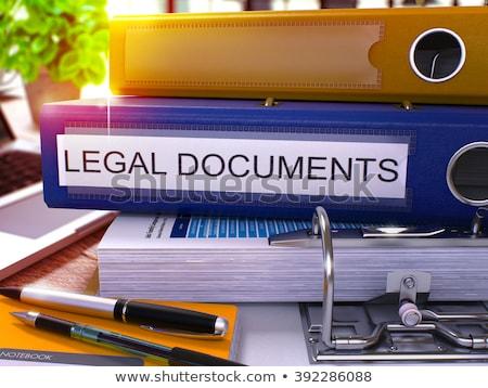 blue office folder with inscription legal documents stock photo © tashatuvango