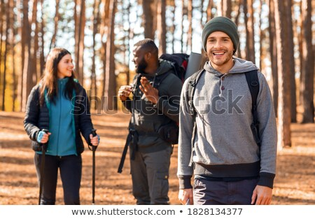multiethnic friends in forest stock photo © lightfieldstudios