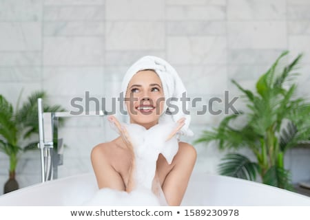 Woman in bathtub, smiling Stock photo © IS2