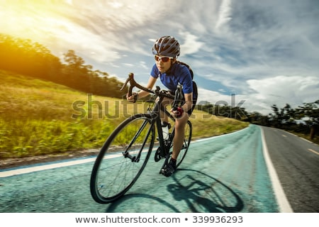 Woman cyclist on bicycle Stock photo © IS2
