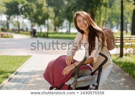 young woman uplifting her baby stock photo © is2