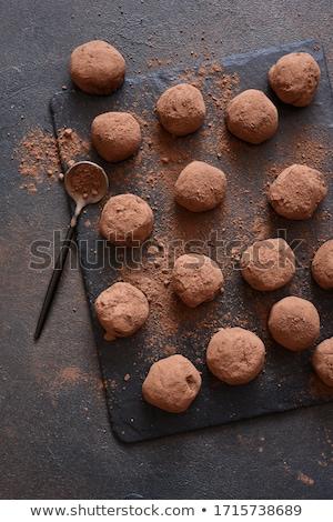 Foto stock: Dark Chocolate Truffles And Cocoa Powder