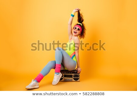portrait of a smiling lovely girl sitting with record player stock photo © deandrobot