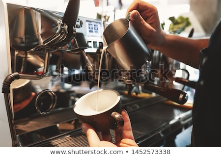 barista standing near coffee machine stock photo © rastudio