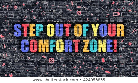 Step Out of Your Comfort Zone Concept. Multicolor on Dark Brick. Stock photo © tashatuvango