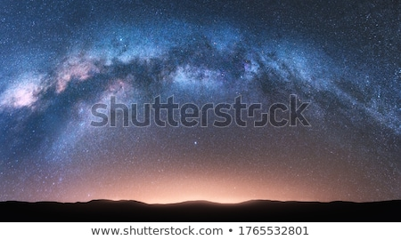 Fantastic night landscape with bright milky way Stock photo © denbelitsky