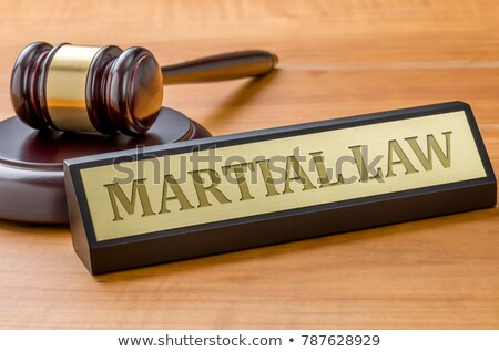 a gavel and a name plate with the engraving martial law stock photo © zerbor