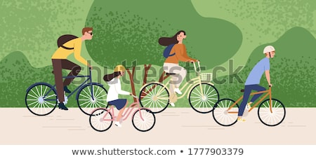 Woman and child cycle together in park Stock photo © IS2