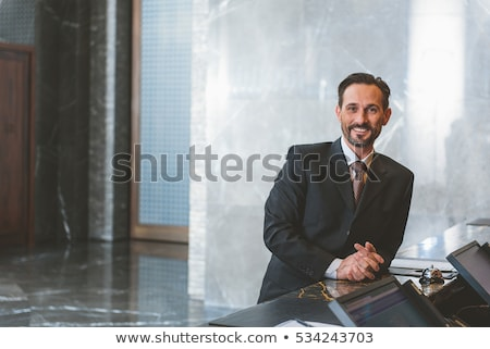 A Senior man checking in at hotel Stock photo © IS2