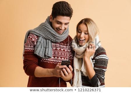 Boldog férfi fülhallgató okostelefon tél fitnessz Stock fotó © dolgachov