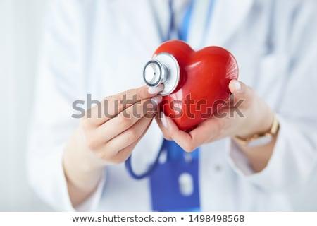 kéz · sztetoszkóp · szív · férfi · tart · piros - stock fotó © CsDeli