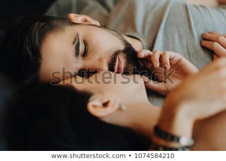 Portret uwodzicielski przystojny mężczyzna dotknąć usta czarny Zdjęcia stock © feedough