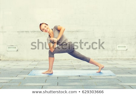 woman making yoga low angle lunge pose outdoors Stock photo © dolgachov