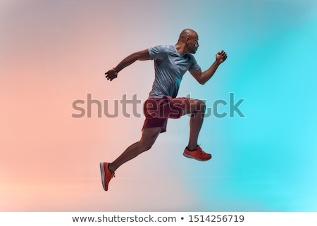full length portrait of a cheerful young african man stock photo © deandrobot