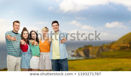 happy friends pointing at you over big sur coast Stock photo © dolgachov