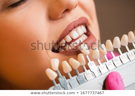 Female Patient's Teeth Being Checked By Dentist Stock photo © AndreyPopov