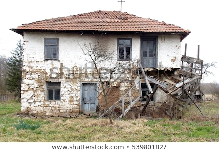 Old house with ruined windows Stock photo © colematt