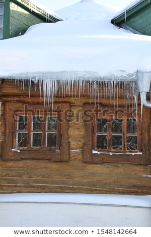 Icicles on the old wooden house Stock photo © Kotenko