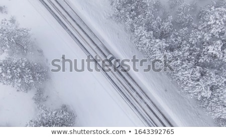 Stock photo: Aerial view of a freeway intersection Snow-covered in winter.