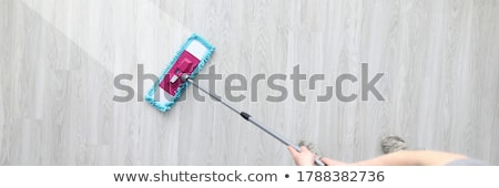 Man Cleaning Floor With Mop Stock photo © AndreyPopov