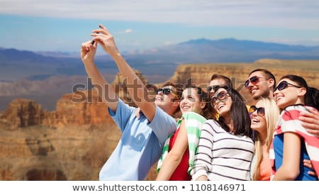 friends taking selfie over grand canyon stock photo © dolgachov