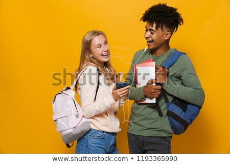 photo of cheerful students man and woman 16 18 wearing earphones stock photo © deandrobot
