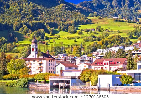 Idyllic Luzern lake village of Hergiswil waterfront view stock photo © xbrchx