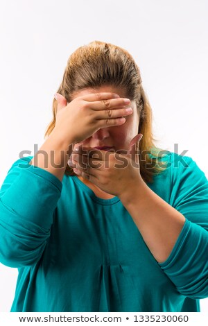 Close-up of fatty woman covering her face Stock photo © Kzenon